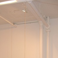 The Reason I Sing, 2007 gold plated chain 10' x 22' x 25' site-specific installation: Sideshow Gallery, Brooklyn, NY